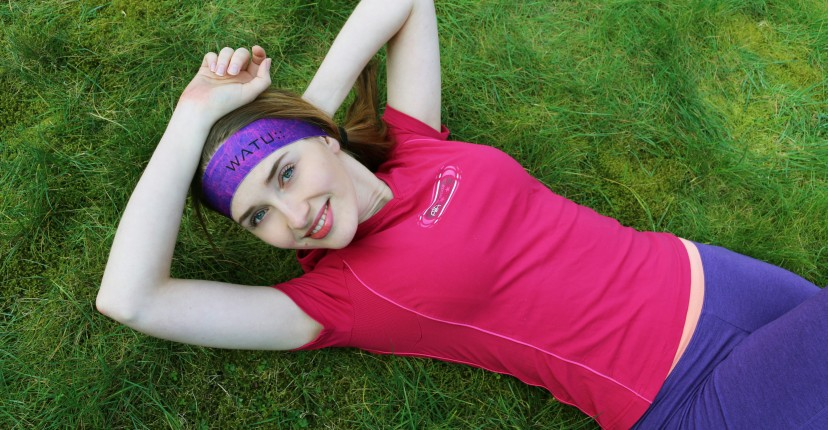 Tatjana lying on the ground wearing WATU headband